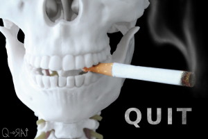 quit-smoking skeleton with cigarette in mouth